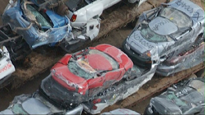 "EV1 vehicles crushed - snapshot from ""Who Killed the Electric Car?"" movie"