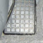2009 Toyota Prius - floor mat tucked securely under the left footrest